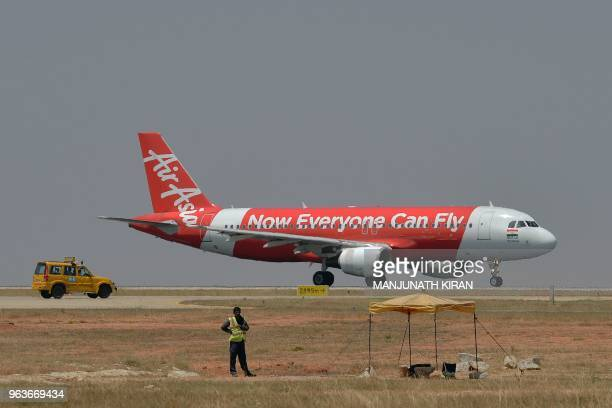 This photograph taken on March 8 2018 shows an airplane of Air Asia the lowcost airline headquartered in Malaysia preparing to take off at the Kempe...