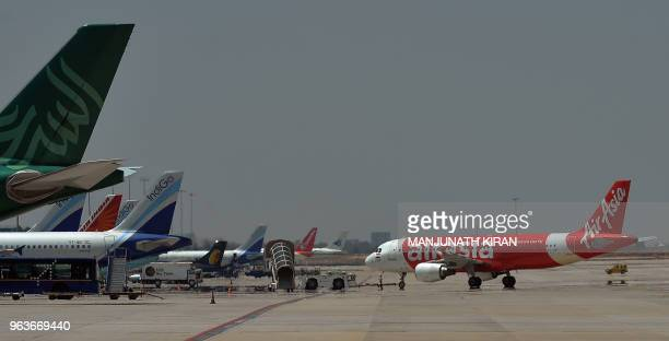 This photograph taken on March 8 2018 shows an airplane of Air Asia the lowcost airline headquartered in Malaysia returning to park after landing at...