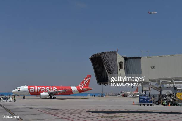 This photograph taken on March 8 2018 shows an airplane of Air Asia the lowcost airline headquartered in Malaysia taxiing before takeoff at the Kempe...