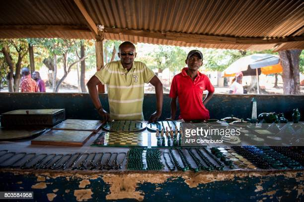 This photograph taken on May 11 shows malachite sellers at their stand at a market in Lubumbashi, DR Congo. There is no electricity in the Congolese...