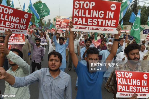 This photograph taken on May 17 2018 shows Pakistani supporters of the JamaateIslami organisation hold placards as they march during a protest...