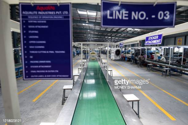 This photograph taken on May 28, 2020 shows a general view of a non-operational conveyor belt as production slowed down at the Aqualite footwear...