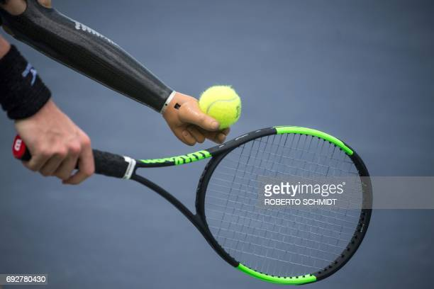 This photograph taken on May 31 2017 shows tennis player Alex Hunt getting ready to serve during a training session with his coach in Bangkok Under...