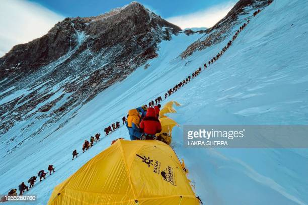 This photograph taken on May 31, 2021 shows mountaineers lined up as they climb a slope during their ascend to summit Mount Everest , in Nepal.