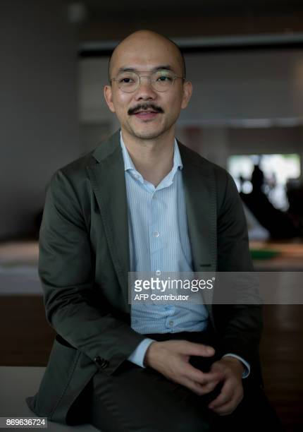 This photograph taken on November 1 2017 shows Aaron Seeto director of the Museum of Modern and Contemporary Art in Nusantara posing for a photo...