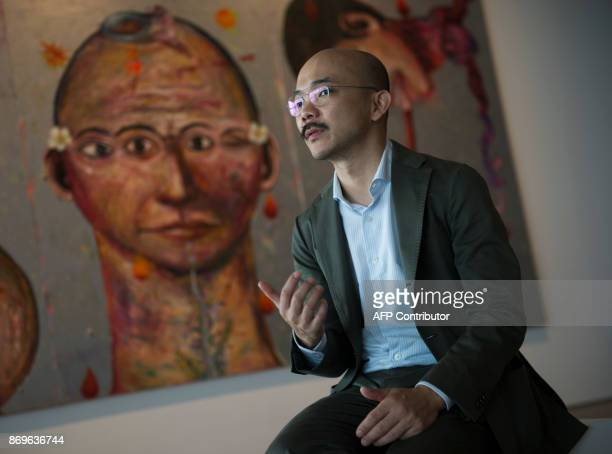 This photograph taken on November 1 2017 shows Aaron Seeto director of the Museum of Modern and Contemporary Art in Nusantara speaking during an...