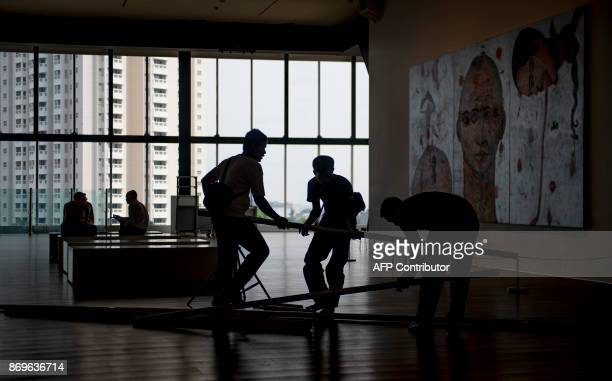 This photograph taken on November 1 2017 shows people setting up artwork at the Museum of Modern and Contemporary Art in Nusantara in Jakarta...
