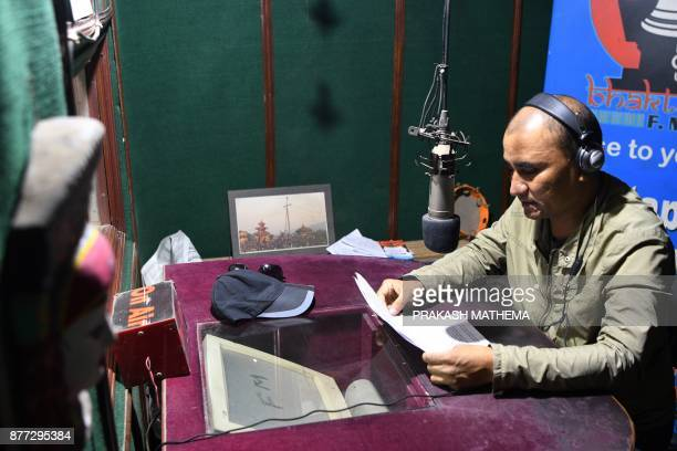 This photograph taken on November 14 2017 shows a Nepali radio broadcaster at a radio station in Bhaktapur some 12km southeast of Kathmandu With days...