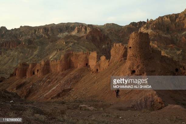 This photograph taken on November 18 2019 shows remnants of the ancient settlement of Zuhak in a valley on the outskirts of Bamiyan After bearing the...