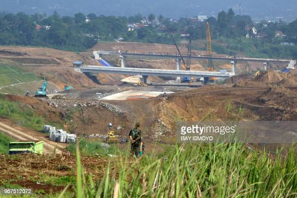 This photograph taken on November 2 2017 shows the construction of a toll road from Jakarta to Lido the planned location for a theme park linked to...