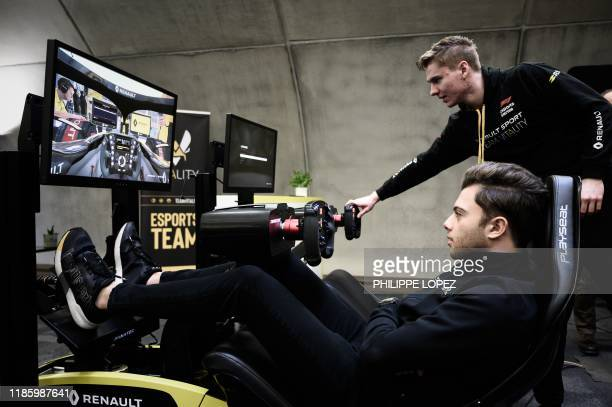 This photograph taken on November 25 shows member of the esport team Vitality Jarno Opmeer of the Netherlands and Renault Sport Academy Driver Max...