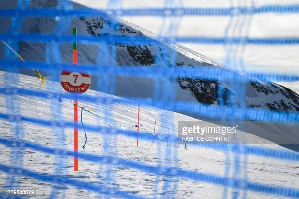 This photograph taken on November 28, 2020 shows a net closing the ski slope of the Cervino Ski Paradise at the Swiss border between Switzerland and...