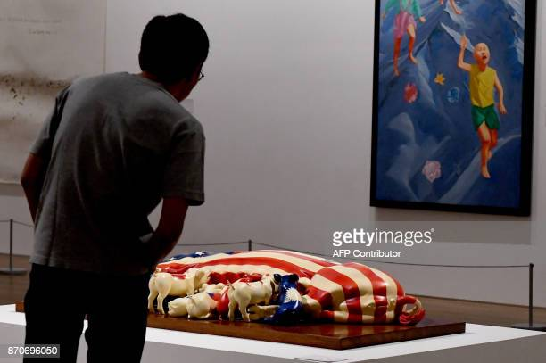 This photograph taken on November 5 2017 shows a visitor admiring an artwork on display at the Museum of Modern and Contemporary Art in Nusantara in...