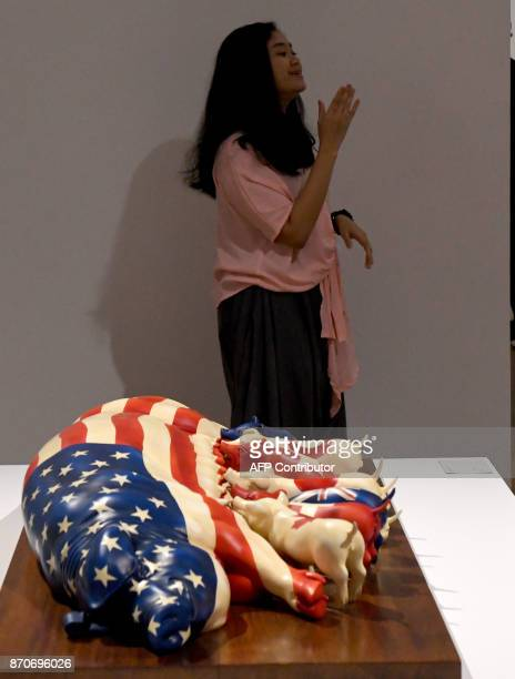 This photograph taken on November 5 2017 shows a visitor reacting to an artwork on display at the Museum of Modern and Contemporary Art in Nusantara...