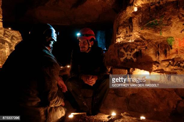 This photograph taken on November 7 shows cataphiles as they talk in the Z room in the banned catacombs of Paris The underground quarries were used...
