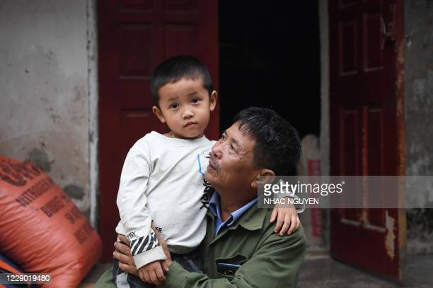 This photograph taken on October 10, 2020 shows Le Minh Tuan, father of the late 30-year-old Le Van Ha who was among 39 people found dead in a truck...