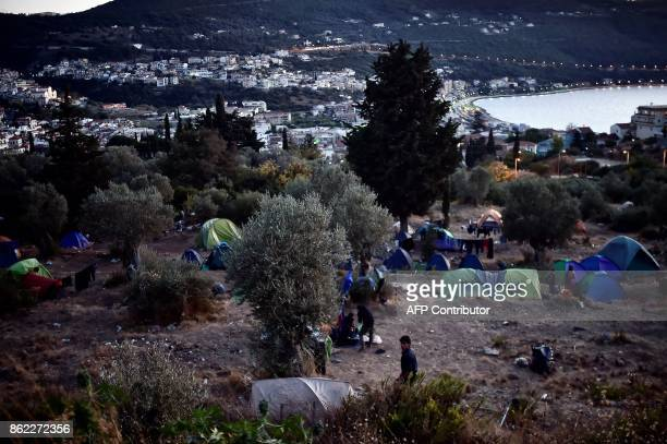 This photograph taken on October 13 shows a general view of tents of refugees among woods on the Greek island of Samos Nearly 300 Syrians Iraqis...