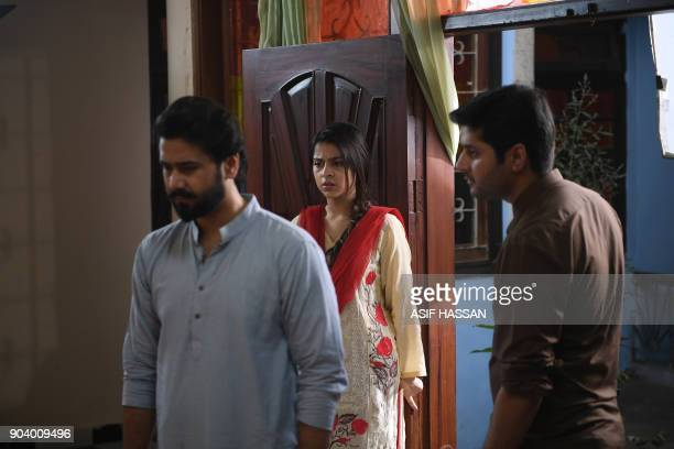 This photograph taken on October 18 shows Pakistani actress Fatima Shah Jeelani and actors Ali Abbas and Imran Ashraf filming the drama serial 'Mein...