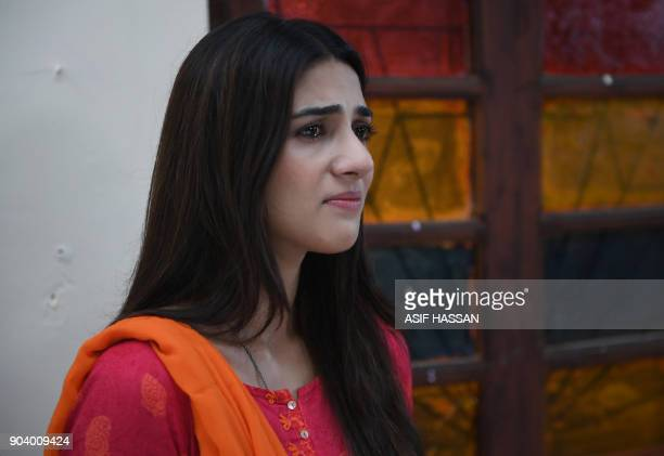This photograph taken on October 18 shows Pakistani actress Rubab Hashim filming the drama serial 'Mein Maa Nahi Banna Chahti' in Karachi There is a...