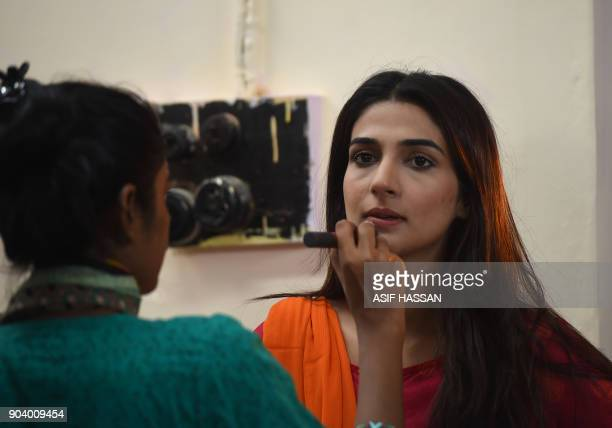 This photograph taken on October 18 shows Pakistani actress Rubab Hashim getting her makeup done as she prepares to film the drama serial 'Mein Maa...