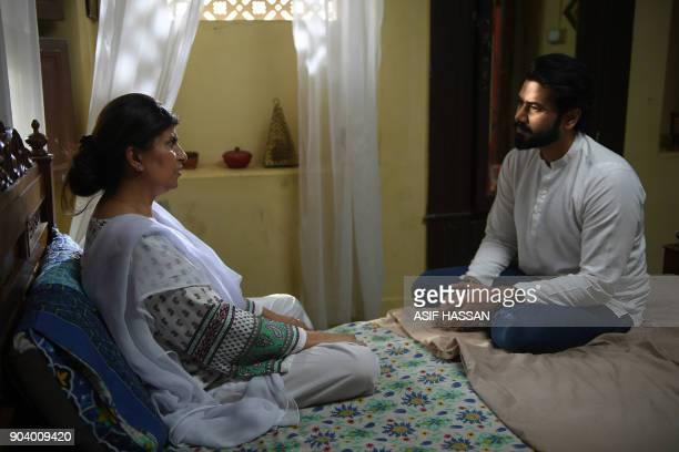 This photograph taken on October 18 shows Pakistani actress Rubian Ashraf and actor Ali Abbas filming the drama serial 'Mein Maa Nahi Banna Chahti'...