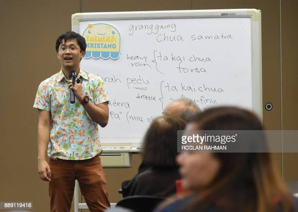 This photograph taken on October 19 2017 shows Kevin Martens Wong 25yearold linguist tutor conducting Kristang language class at the national library...