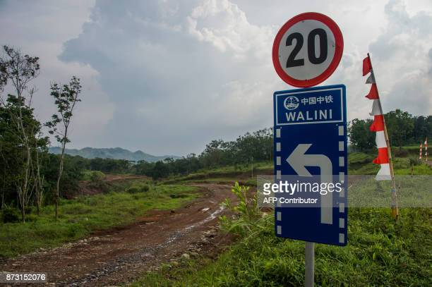 This photograph taken on October 20 2017 shows a sign including Chinese characters erected on the land where the JakartaBandung highspeed rail will...