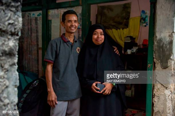 This photograph taken on October 24 2017 shows Sriyono who suffers from asbestosis scarring of the lungs from breathing in asbestos fibres posing...