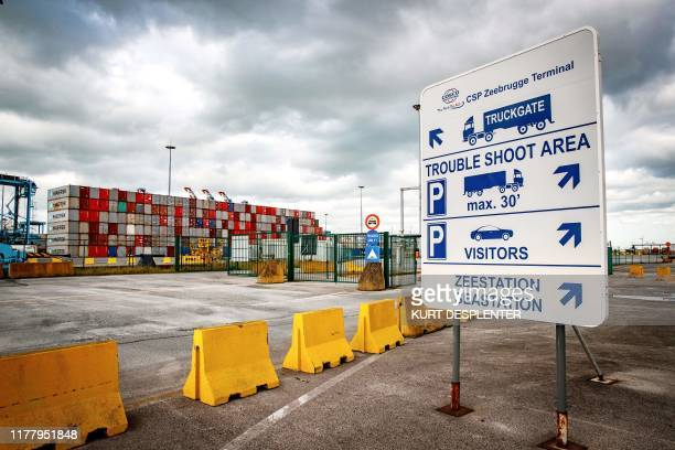 This photograph taken on October 24 shows traffic signs at the Belgian port of Zeebrugge. - British police said a truck with 39 bodies found on...