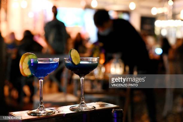 This photograph taken on October 25, 2020 shows cocktails displayed outdoor a wine-bar after last government's tightened nationwide coronavirus'...