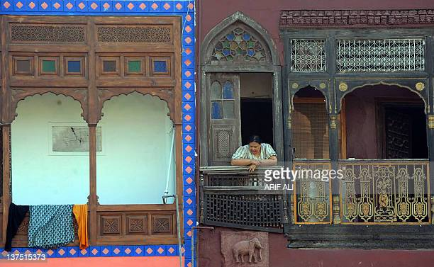 This photograph taken on October 29 2011 shows a Pakistani woman looking out from a balcony in the old residential walled city of Lahore The medieval...