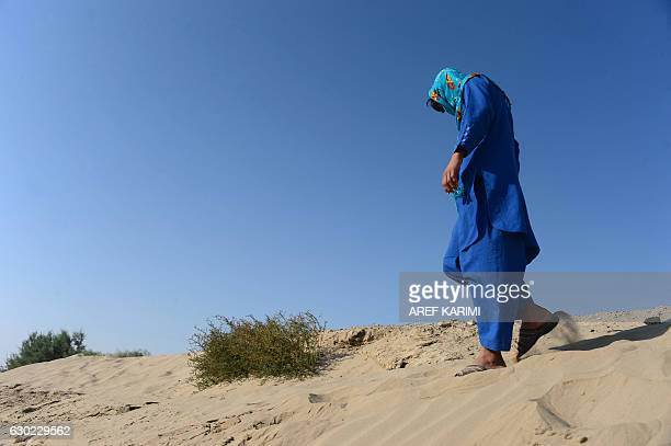 This photograph taken on October 31, 2016 shows an Afghan boy, who was held as a child sex slave, walking in a unidentified location in Afghanistan....