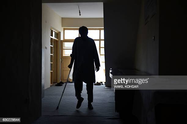 """This photograph taken on October 5, 2016 shows Shirin, the brother-in-law of a """"bacha bazi"""" victim, a teenage boy, arriving ahead of an interview..."""