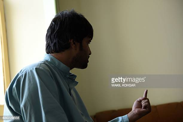 """This photograph taken on October 5, 2016 shows Shirin, the brother-in-law of a """"bacha bazi"""" victim, a teenage boy, gesturing as he talks during an..."""