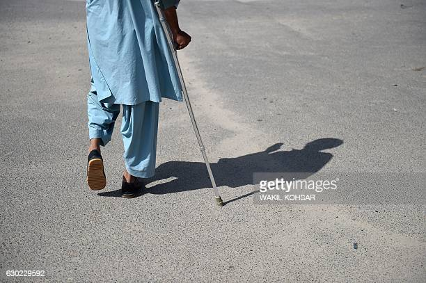 """This photograph taken on October 5, 2016 shows Shirin, the brother-in-law of a """"bacha bazi"""" victim, a teenage boy, as he walks along the street in..."""