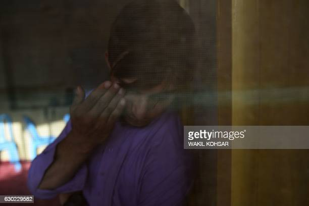 """This photograph taken on October 6, 2016 shows Bashir, a relative of a """"bacha bazi"""" victim, a teenage boy, during an interview with AFP in Lashkar..."""