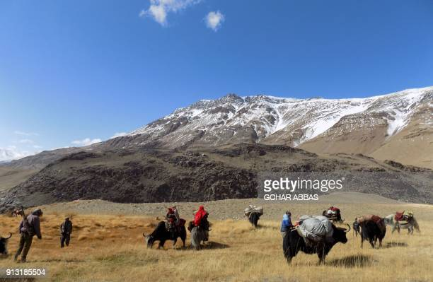 This photograph taken on October 7 2017 shows Afghan Wakhi nomad families travelling on yaks in the Wakhan Corridor in Badakhshan province of...