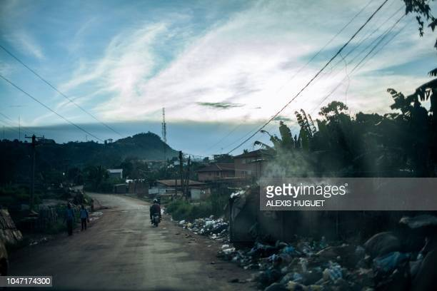 TOPSHOT This photograph taken on October 7 2018 during Cameroon's presidential election shows an empty street in downtown Yaoundé the capital city of...