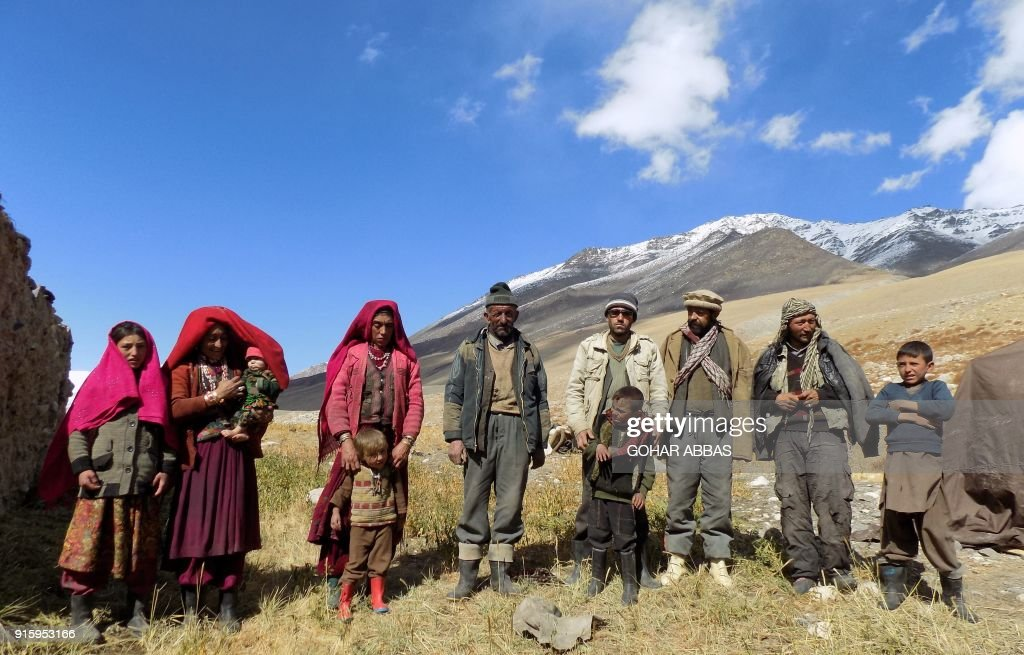 This photograph taken on October 8, 2017 shows Afghan Wakhi nomad family posing for a picture in the Wakhan Corridor in Afghanistan. The region is so remote that its residents, known as the Wakhi - a tribe of roughly 12,000 nomadic people who populate the area - are untouched by decades of conflict devastating their country. / AFP PHOTO / Gohar ABBAS / TO GO WITH Afghanistan-Wakhan-Taliban-war,FEATURE by Gohar Abbas