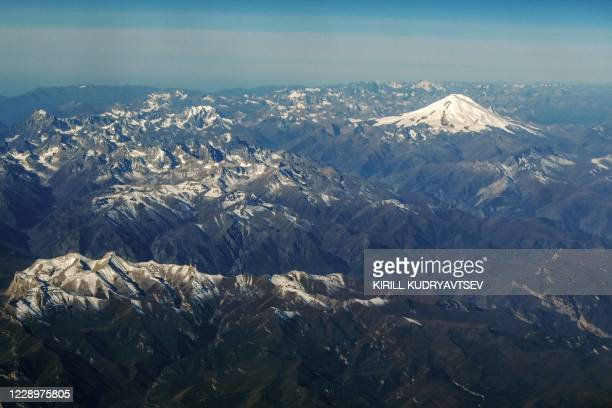 This photograph taken on October 9, 2020 shows an aerial view of the Caucasus mountains in Russia with the mount Elbrus in the background.