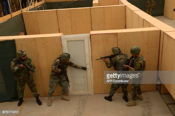 This photograph taken on on November 11, 2017 shows Afghan National Army commandos taking part in a military exercise at a training centre in Herat....
