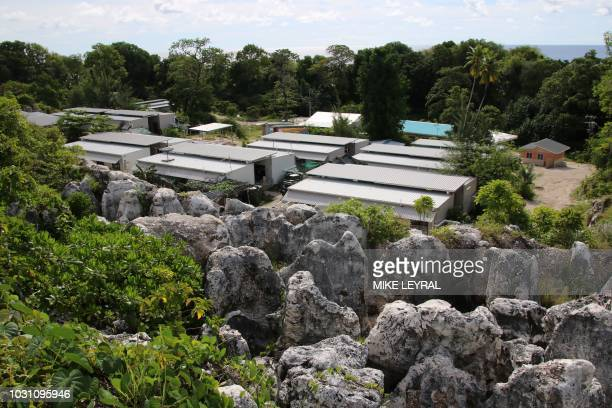 This photograph taken on September 2 2018 shows a general view of refugee Camp Four on the Pacific island of Nauru A cluster of corrugated iron huts...