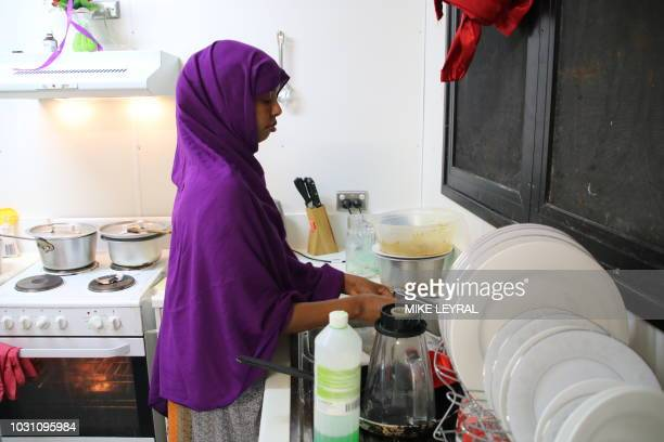 This photograph taken on September 2 2018 shows a refugee from Somalia who had attempted suicide doing kitchen chores at Camp Five on the Pacific...