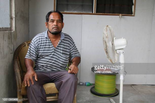 This photograph taken on September 2 2018 shows a Sri Lankan refugee looking on in Anibare on the Pacific island of Nauru A cluster of corrugated...