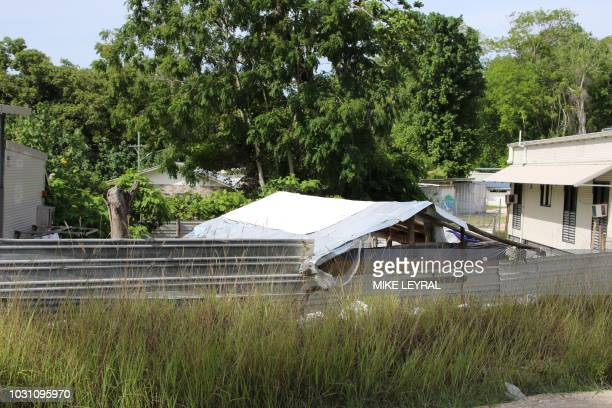 This photograph taken on September 2 2018 shows a view of a dwelling at refugee Camp Four on the Pacific island of Nauru A cluster of corrugated iron...