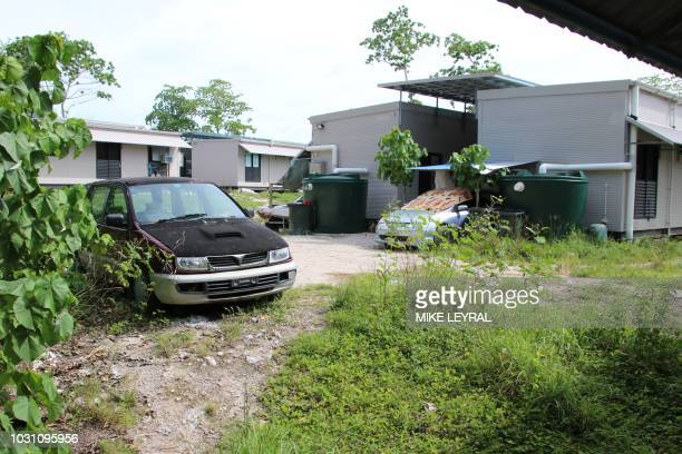 This photograph taken on September 2 2018 shows a view of dwellings at refugee Camp Four on the Pacific island of Nauru A cluster of corrugated iron...