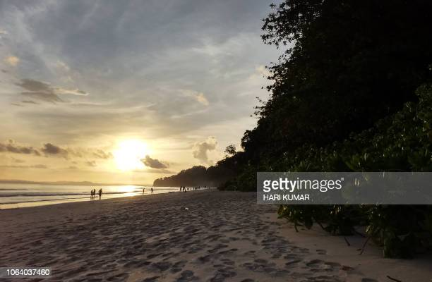 This photograph taken on September 23 2018 shows sunset on Havelock Island a tourist haven in the Andaman Islands a remote Indian archipelago in the...