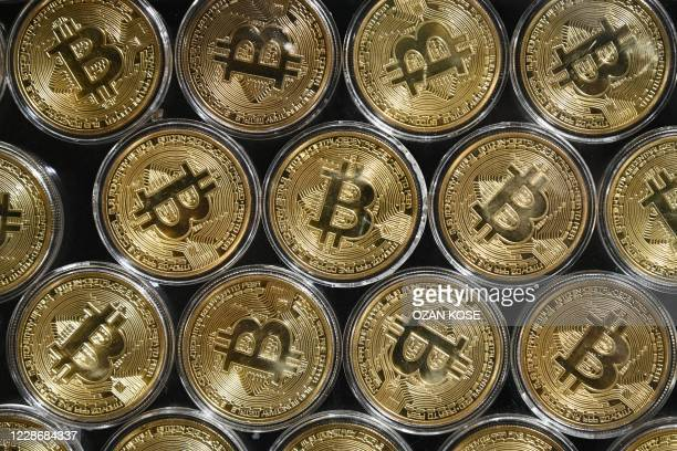 """This photograph taken on September 24, 2020 shows a physical imitation of a Bitcoin at a crypto currency """"Bitcoin Change"""" shop, near Grand Bazaar, in..."""