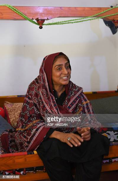This photograph taken on September 27 shows Pakistani woman Mukhtiar Naz known as Waderi Nazo Dharejo sitting in a cradle as she speaks during an...