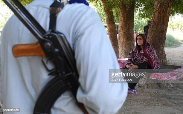 This photograph taken on September 27 shows Pakistani woman Mukhtiar Naz known as Waderi Nazo Dharejo meeting with workers near her home in Qazi...